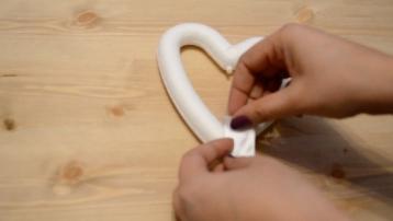 placing-ribbon-on-heart