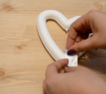 placing-ribbon-on-heart