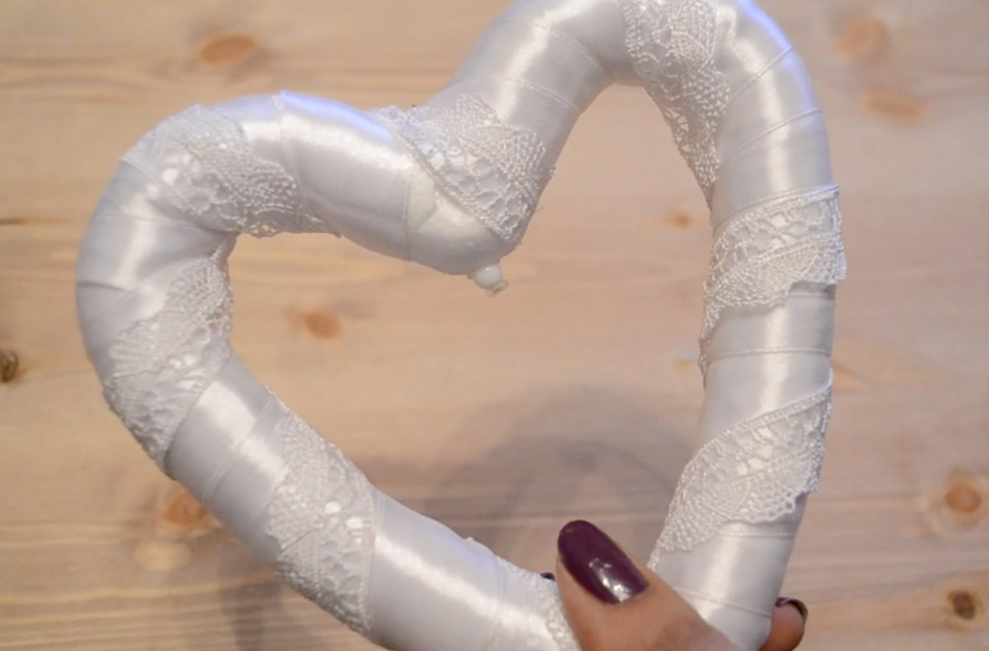 Lace ribbon wrapped around heart