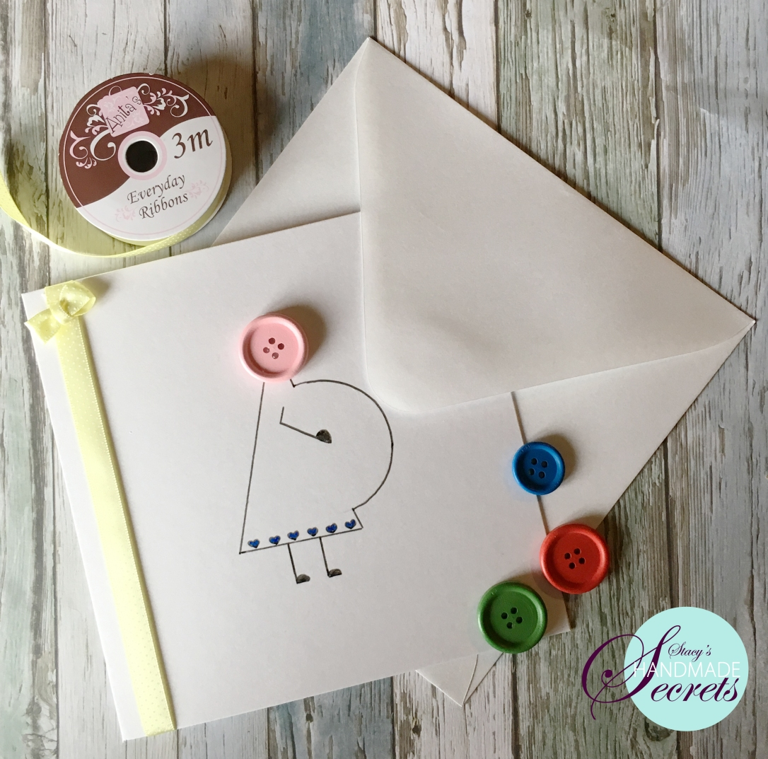 DIY greeting card with pregnant stick-woman made with buttons
