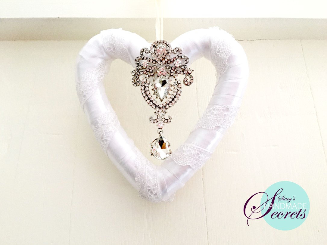 white brooch heart w logo