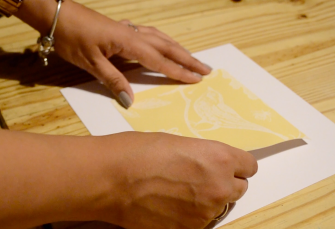 Gluing a cut out piece of decorative paper down to create an aperture