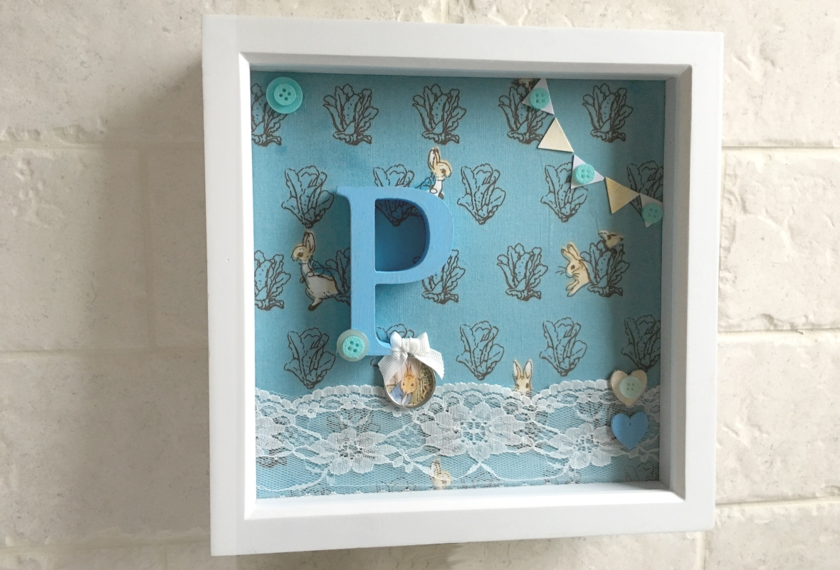 Peter Rabbit Boxframe on a tiled wall