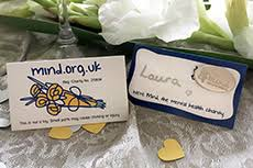Silver mind badge wedding favour