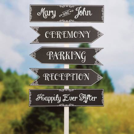 5 wedding signs on a wooden post